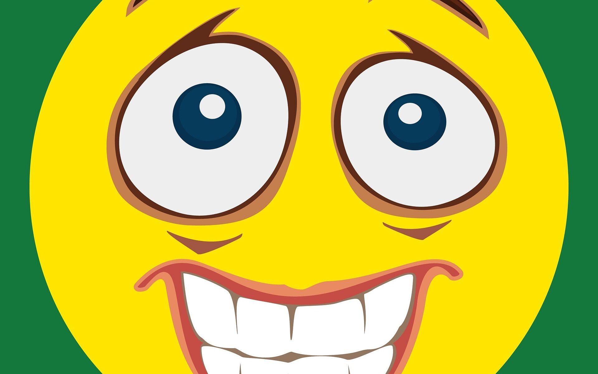 émoji sourire figé et les yeux exorbités